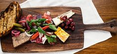 LA Restaurant A.O.C.'s Vitner's Plate: pork rillettes, cheese, roasted grapes, pickled veggies, and sliced salumi | One Kings Lane