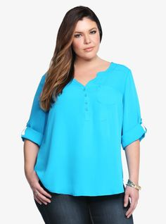 Ready for a bright touch? This beautiful turquoise top is a real eye-catcher. In lightweight georgette, this easy-flowing blouse was made for a sunny day. Finished with a Mandarin collar and 3/4 button-tab sleeves, this contemporary style is perfect for dressing up or down.