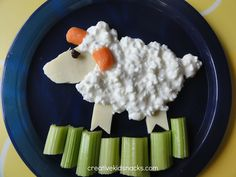 Create a little lamb for your little lamb by using some mozzarella cheese cut into somewhat of an oval for the face and little rectangles with a point cut out for the legs. Next, use a small spoo…