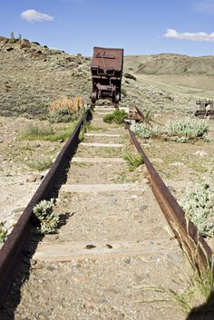 Tracks at an abandoned mine near Lander.here there is an obvious theme of Earth, but also it shows to me how the people has influenced on it. For example industrialization and urbanization.