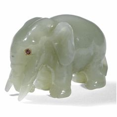 A Fabergé carved bowenite model of an elephant, circa 1900 realistically and humorously modelled, the eyes set with rubies length: 3.8cm., 1 1/2in