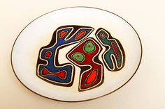 "Enamel on Copper concave circular plate - Ellamarie and Jackson Woolley. Incorporating many colors on heavy gauge copper , a strong example of their work. Signed & numbered 3767. 6-1/2"" diameter"