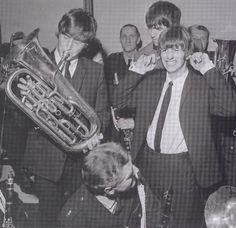 Beatles playing a Besson
