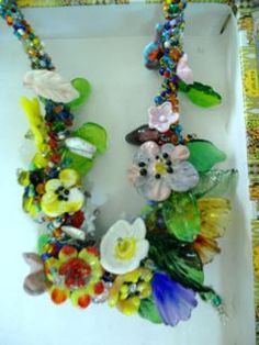 Multi glass flowers made on the torch assembled into a necklace. #glassbeads