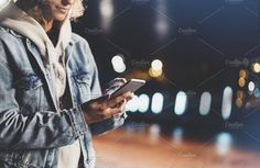 Ad: Girl enjoys smart phone in the city by A_B_C on Girl pointing finger on screen smartphone on background illumination bokeh color light in night atmospheric city, hipster using in female