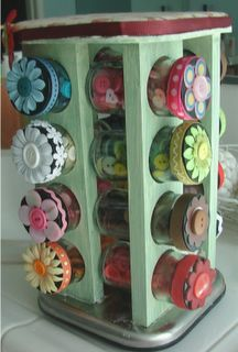 Turn a spice rack into storage for buttons or other small goodies. I'd like to use it for my jewelry making stuff! All my beads and fastenings
