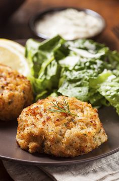"""""""- Crab Cakes with Spicy Cream Ingredients: Canola oil cooking spray 2 teaspoons canola oil 2 scallions, thinly sliced, green and white parts 1 medium…"""" Homemade Crab Cakes, Crab Cake Recipes, Sauce Recipes, Fish Recipes, Seafood Recipes, Dinner Recipes, Cooking Recipes, Healthy Recipes, Seafood Dishes"""