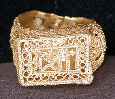 Ring  Object Name: Ring Date: 11th century Geography: Egypt Medium: Gold; filigree and granulation Dimensions: Max. Diam. 15/16 in. (2.3 cm) Width. 7/16 (1.1 cm) BezeL. L. 5/8 in. (1.6 cm) Classification: Jewelry Credit Line: Gift of Mr. and Mrs. J. J. Klejman, 1971