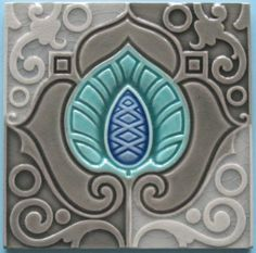 ¤ A fantastic moorish-inspired swirling art nouveau design in three shades of gray, brilliant turquoise and blue from the Belgian firm, Hemixsem.