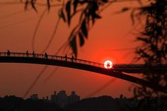"""Sunset at Seonyudo Bridge in Seoul -   Also known as the """"Footbridge of Peace"""", this bridge is used only for pedestrians and links Seonyu Park and the Yanghwa district, just to the west of Yeouido Island."""