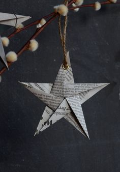 Recycled Newspaper Christmas Hanging Star by BeneathTheWeather I want to do this!