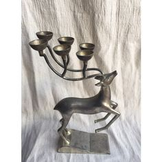 Godinger Reindeer Candelabra ($38) ❤ liked on Polyvore featuring home, home decor, candles & candleholders, godinger candlestick holders, antler candelabra, godinger, antler home decor and antler candle holder