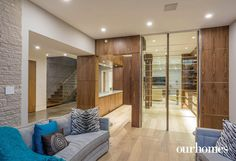 The lower level includes a show-stopping wine room and bar area. - via OUR HOMES Oakville Winter 2016/New Year 2016