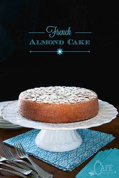 Vertical Image of French Almond Cake on a white cake stand with text.