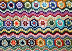 """Inspiration :: Hexagon Granny Ripple, pattern by Vicki Becker in the book """"Vintage Afghan Favorites, Volume 1: Granny and Ripple Afghans"""" c.2012 . . . . Hexagon grannies are first crocheted, then sewn together to form rows. A granny-style ripple is then crocheted to either side of the hexagon strips. ღTrish W ~ http://www.pinterest.com/trishw/ . . . . #crochet #blanket #throw"""