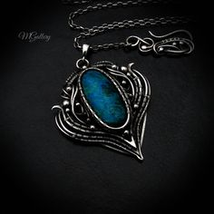 Silver pendant with chrysocolla wire-wrapping. by GaleriaM on Etsy