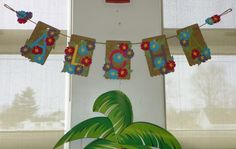 A-L-O-H-A Banner using Stampin' Up! Cardstock and Silhouette Cameo for my granddaughter's 7th birthday laua party. Debbie Henderson, Debbie's Designs.