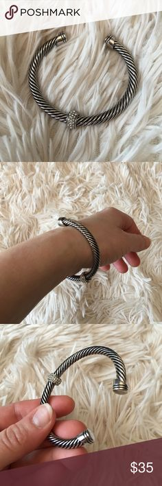 DY Style Silver Bangle Gorgeous bangle only worn a couple of times looks brand new no scratches or sign of wear. Looks like David Yurman but no brand or markings not actual David Yurman just looks like it. Jewelry Bracelets