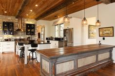 This kitchen is bigger than my kitchen, dining room and living room combined.  I'd KILL to have it.
