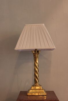 A good quality and of elegant design mid to late 20th century a late 19th century english classical table lamp in brass having been rewired to uk greentooth Gallery