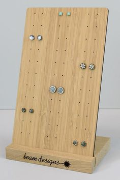 Wooden stud earring stand for craft and shop jewellery displays.