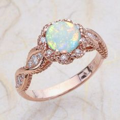 14K Vintage Rose Gold Engagement Ring Center Is A Round Opal by EJCOLLECTIONS on Etsy https://www.etsy.com/listing/493819072/14k-vintage-rose-gold-engagement-ring