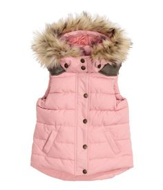 Padded vest with imitation leather details, detachable lined hood with faux fur trim, and zip and wind flap at front with snap fasteners. Fleece-lined side pockets. Lined.