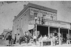 Dodge City, Kansas Circa The Long Branch Saloon is partially shown to the right of the Wright Beverly Co. Old West Town, Old Town, Dodge City Kansas, Old Western Towns, Western Homes, Old West Photos, Into The West, American Frontier, Le Far West