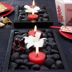 Great idea for a (Chinese New Year) party tablescape. Add some candles & rocks to a black frame & we're all set.
