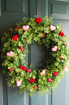 Made from grapevine wreath and boxwood picks from Garden Ridge. Hearts are temporary from Dollar Tree. Plan on changing it for each season or holiday.