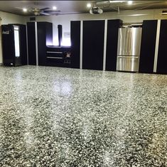 3rd Place $50 Winning Photo – Nick M. of California --  Nick with Epoxy Floors sent in this shot showing off our Epoxy Flooring used in a garage installed next to our Garage Storage Cabinets. His customer chose a 1-inch Salt & Pepper Color for the floor and they went with matching Black Cabinets with our Aluminum Extruded Pulls. We really like how this shot shows off how well our Epoxy Coatings and Garage Storage Cabinets work together to provide a functional garage.