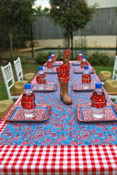 Table settings at a Cowboy Party #cowboy #partytable  I like using the blue fabric over the red gingham check.