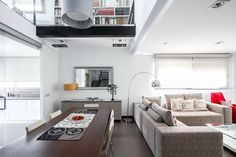 Love that open ceiling over dining table- House v02 by Viraje Arquitectura