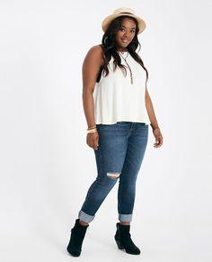 """<p>A pair of classic cropped jeans featuring a soft denim body, a slit knee design, a roll cuff hem, a 5-pocket design, and belt loops.</p>  <p>Model wears a size 14.</p>  <ul> <li>Mid-Rise</li> <li>Zip Fly / Single Button Closure</li> <li>28"""" Inseam</li> <li>12"""" Leg Opening</li> <li>74.8% Cotton / 24.1% Polyester / 1.1% Spandex</li> <li>Machine Wash</li> <li>Imported</li> </ul>"""