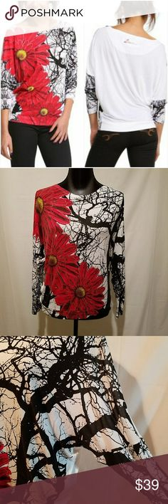 """Desigual Claudia Floral Print T-shirt This is a Desigual Claudia floral print t-shirt. - 100% viscose Excellent used condition, no wear Approximate measurements - flat: Dolman/batwing  Length from shoulder to bottom: 23 1/2"""" u7 Desigual Tops Tees - Long Sleeve"""
