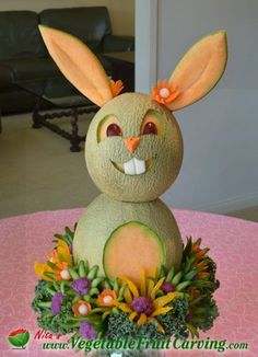 Easter Bunny Centerpiece Carved from Cantaloupe. Get details about the ingredients on my blog at http://www.vegetablefruitcarving.com/blog/easter-centerpieces-party/