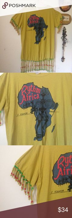 🆕 Rythm Africa fringe beaded oversize tee/coverup Awesome oversized tee with beaded fringe and graphic print on the front. Tee reads Rythm Africa with graphic of the African continent. Yellow tee with green and red beads and fringe at the sleeves and hem. Oversized fit makes this top perfect over leggings or as a swimsuit cover up. Like new condition except for one missing bead as seen in 4th pic. Could fit size S to XL or bigger. Vintage Tops Tees - Short Sleeve