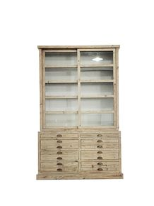 """We provide a soft washed gray finish to this attractive and practical cabinet. Picture it in a casual dining area or in you office as storage. Slide the doors, adjust the shelves, open the drawers. It""""s all good - especially the 102"""" height.  Pine 2 Sliding Glass Doors  63""""w x 20""""d x 102""""h  8 Drawers 3 Adj.Shelves Natural"""