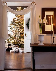 White fabric strung through gold hoops makes an elegant alternative to traditional Christmas garlands.