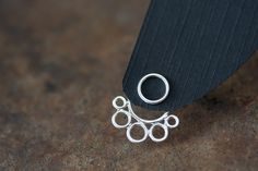 Handcrafted silver ear jacket earrings, front and back earring, solid sterling silver circles, geometric bubble earrings, trendy earrings by CookOnStrike on Etsy https://www.etsy.com/listing/227956307/handcrafted-silver-ear-jacket-earrings