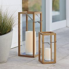 """Clean-lined lanterns cast a warm glow in the home or on the patio framed in unfinished teak and topped with a notched square stainless steel handle.<br /><br /><NEWTAG/><ul><li>Unfinished teak</li><li>Stainless steel handle</li><li>Indoor or outdoor use</li><li>Large accommodates up to 4""""-diameter pillar candle, sold separately</li><li>Small accommodates up to 3""""-diameter pillar candle, sold separately</li><li>Made in Indonesia</li></ul>"""