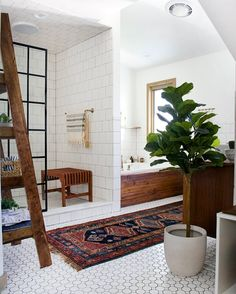 totally obsessed with this eclectic vintage modern bathroom. Love that shower and built-in tub!