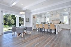 This spacious kitchen and dining area has an open concept, creating a large space with plenty of room for guests.