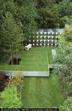 very nice, may work for the front,with different levels, with big tress and to give some green color in areas that get sun exposure for the lawn, other areas with hardscape with crushed rock Lawn levels // Diarmuid Gavin