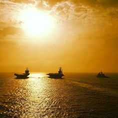 Talk about a photo op. The aircraft carriers USS Enterprise and USS Dwight D. Eisenhower and the guided-missile cruisers USS Vicksburg and USS Hué City head toward the sunrise in formation during a passing exercise. #Navy #USNavy #AmericasNavy navy.com