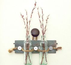 A great idea is to make wall art and to reuse the bottles.  A touch of spring in your house!
