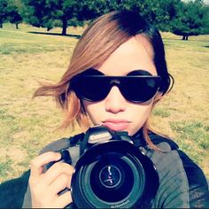 big sunnies & camera..