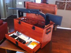 Custom made gun box for storing gun cleaning items, holster, scopes and work bench.  I made this in my garage, I got the design from a different gun cleaning kit, but I made it bigger and better.