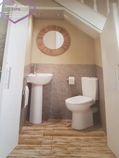 Downstairs under stairs toilet idea. I like how the doors open and it has a corner toilet toilet downstairstoilet - Home Projects We Love Tiny Bathrooms, Modern Bathroom, Small Bathroom, Corner Toilet, Small Toilet, Bathroom Under Stairs, Basement Bathroom, Basement Remodeling, Bathroom Renovations