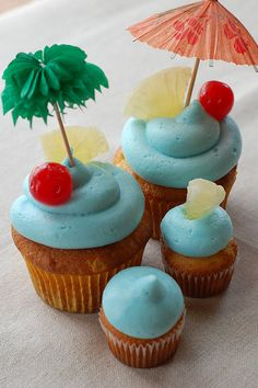 Blue Hawaiian cupcakes. Pineapple coconut rum cake topped with pineapple & Blue Curaçao buttercream frosting. -- make for Lonnia's birthday